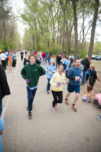 Ryan at 19 (green sweatshirt) running in the 2013 Mother's Day 5k.