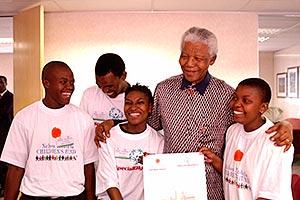 300x200-Mandela-group-smiling-2004