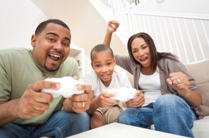 family-playing-video-game-console